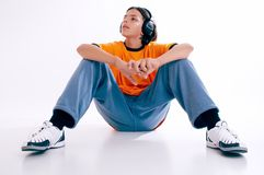 Music. Boy with headphones listen music and emjoy Royalty Free Stock Images