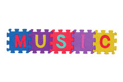 MUSIC. Letters-puzzle, word Music,  isolated on white background Stock Photography
