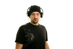 Music. Man on a white background with headphones Royalty Free Stock Photography