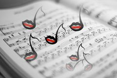 Music. Abstract concept of a song book and singing musical tones Stock Photos
