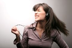 Music 1505. A pretty girl dance with ear-phones Royalty Free Stock Photos