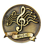Music. A bronze medallion with musical symbols and the word music engraved