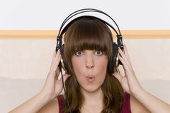 Music. Beautiful young woman with headphone royalty free stock images