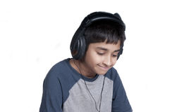 Music. An handsome Indian kid enjoying music with lots of fun Stock Image