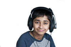 Music. An handsome Indian kid enjoying music with lots of fun Stock Images