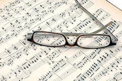 Music. Notes of classic music with eyeglasses Stock Photo