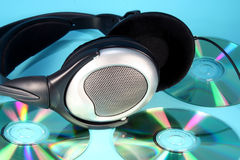 Music 3. Headphones on a pile of cds royalty free stock image