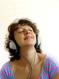Music. Attractive woman listening to music Royalty Free Stock Photos