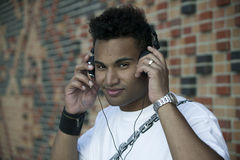 Music 3876. Young man with headphones listening to music stock photography