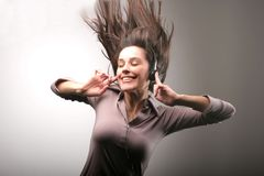 Music. A girl dance with a ear-phones Stock Image