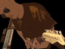 Music. A photo processed in PS of a man playing guitar with keyboards around him Stock Photo