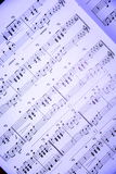 Music. Notes on blue background Stock Images