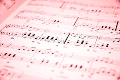 Music. Notes on red background Stock Photography