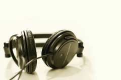 Music. Black headphones against white background Royalty Free Stock Photo