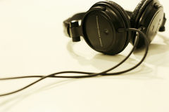 Music. Black headphones against white background Royalty Free Stock Image
