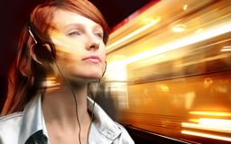 Music. A young woman listen music Stock Image