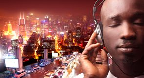 Music. A man listen the music with a ear-phones in a city stock photography