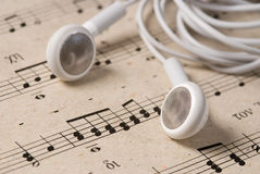 Music. Old sheet music and headphones Royalty Free Stock Images