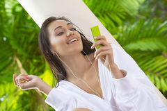 In music. Portrait of young pretty woman in summer environment stock image