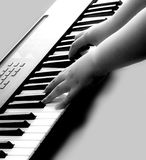 Music. Closeup view of someone playing some music on an electronic keyboard Stock Images