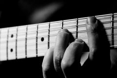 Music Accord; Detail Of Hand On Guitar Royalty Free Stock Photography