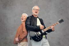 Happy senior couple with electric guitar singing Royalty Free Stock Photography