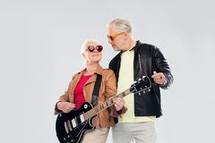 Senior couple in sunglasses with electric guitar Royalty Free Stock Image