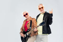 Senior couple with guitar showing rock hand sign Royalty Free Stock Photos