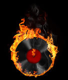 Music and all things related. Illustration of vinyl record in fire on the black background Royalty Free Stock Photography