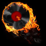 Music and all things related. Illustration of analog vinyl record in fire on the black background Royalty Free Stock Image