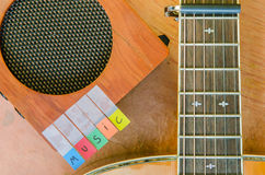 Music alphabet with acoustic guitar Stock Images