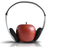 Music and apple. Modern music and red apple Royalty Free Stock Image