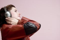 Music appreciation. Side view of a girl listening to music Stock Photos