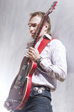 Music and Art Concepts. Portrait of Expressive Male Guitar Playe Royalty Free Stock Photos