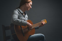 Music Artist - Female Guitarist Stock Photography