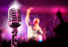 Music background. With vintage microphone and concert