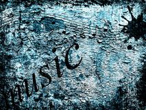 Music background. Abstract background in grunge style with scratches, marks and music elements in blue and black colours Royalty Free Stock Photos