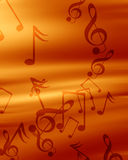Music background. Red background with some music notes on it Stock Photography