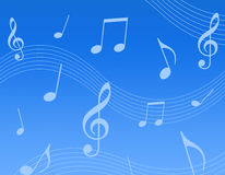 Music background. Clean blue background with white color music notes. good for web backgrounds etc Royalty Free Stock Images