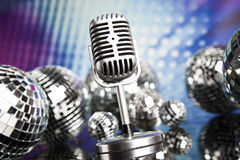 Music background, microphone and Disco Balls Stock Image