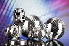 Music background, microphone and Disco Balls Royalty Free Stock Photography