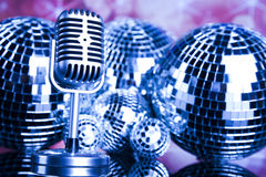 Music background, microphone and Disco Balls Stock Photo
