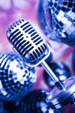 Music background, microphone and Disco Balls Stock Images