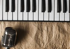 Music background with piano and retro microphone. On grunge paper texture Royalty Free Stock Photography