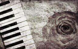 Music background with rose. Abstract grunge rose and piano, vintage music background Royalty Free Stock Image