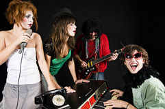 Music band. Of four youngsters performing Stock Photography