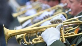 Music band. Hands of musicians with trumpets (selective focus Royalty Free Stock Image