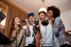 Music band during cd recording in studio.  stock images