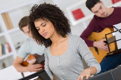Music band during cd recording in studio. Teen royalty free stock photography