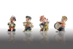 Music band figurine. Included Saxophone, Guitar, Double bass and Drum  on white with reflect Stock Photography